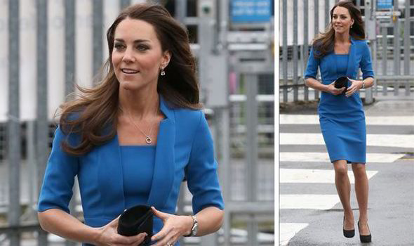 66990c28040 Kate wore a Detroit blue figure hugging dress to a west London school today