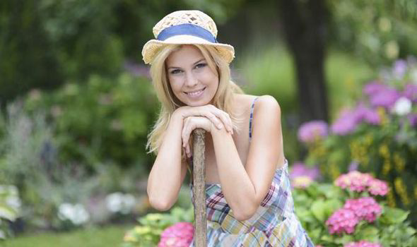 Great A Woman Smiling In The Garden Awesome Design