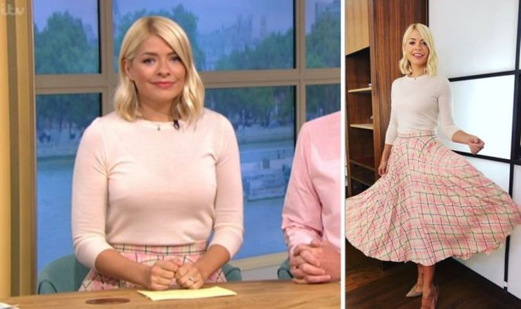 5ca91613e2 Holly Willoughby flaunts her trim waist in her usual knitted jumper and  checked midi skirt