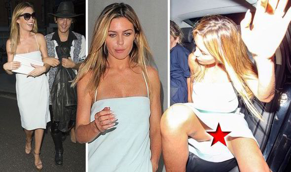 Abbey Clancy looks a little worse for wear as she flashes her ... 43b3bdec0