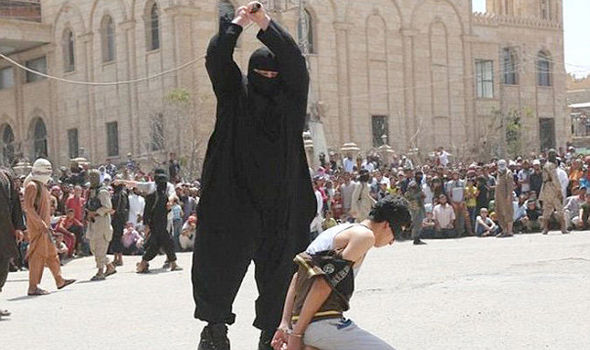 Islamic State - 'The Bulldozer' beheads teenager for