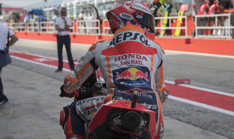 fc4126e788f48 MotoGP Marc Marquez qualifying crash  Watch INCREDIBLE sprint to Honda  garage