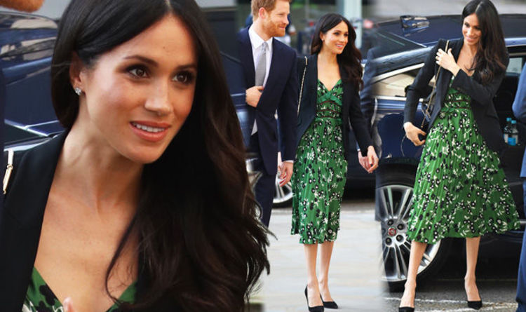 21bc9d10c9 Meghan Markle wears DARING low cut £385 dress next to Prince Harry on  Queen s birthday