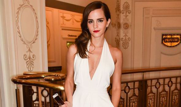 c74c0259891 Emma Watson goes for the plunge in sexy white jumpsuit