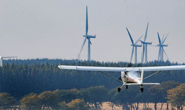 Image result for image of wind turbines and small planes