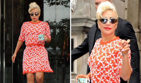 500fc11d7b9 Lady Gaga covers up after wearing see-through dress at London gig ...