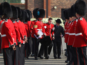 00fc6f24466 A soldier from the Irish Guards is helped from the Victoria Barracks parade  ground yesterday