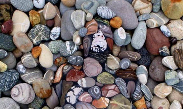 An Optical Illusions Made Up Of Pebbles