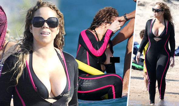 Mariah Carey Suffers Nip Slip After Her Plunging Bikini Struggles To Contain Her Curves