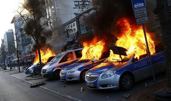 Three Police Cars On Fire During A Protest In Frankfurt