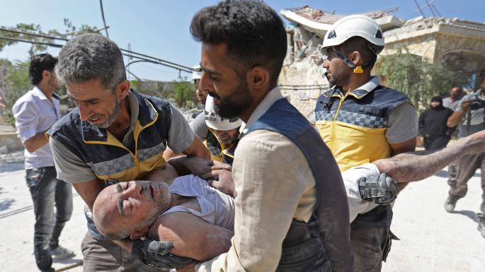 Syrian rebels give up key stronghold after months of bombing