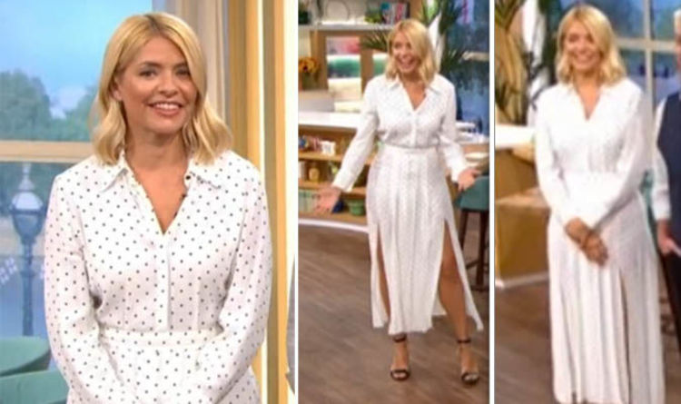 9e5cedcea5d150 Holly Willoughby shows off toned legs in thigh splitting polka dot skirt on  This Morning
