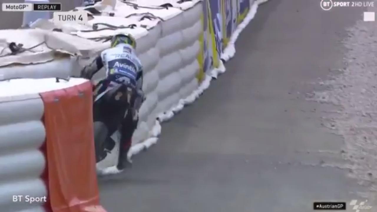 Austrian MotoGP: Karel Abraham crashes into side of track
