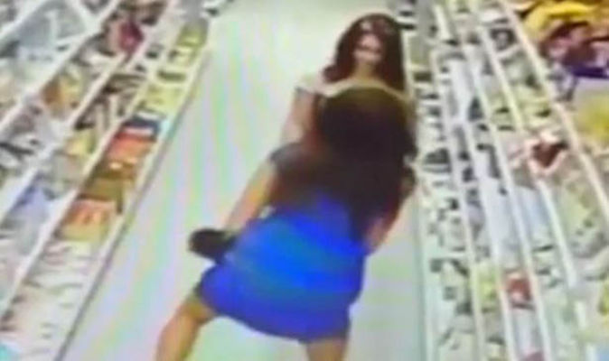 Shoplifters caught on camera 'hiding sweets in their