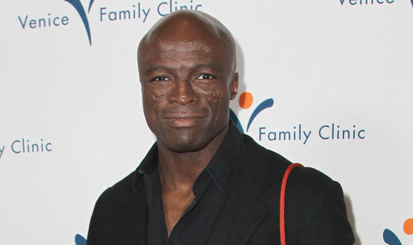 Who is seal the singer dating football