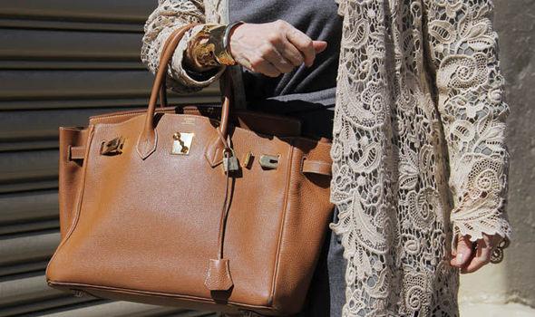 Woman Holding A Birkin Handbag